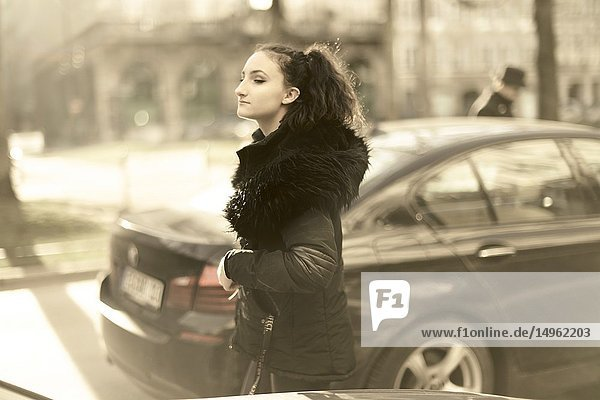 Woman outdoors at street  in city Munich  Germany.