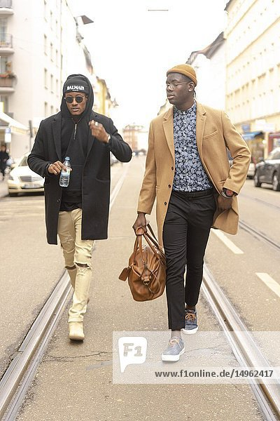 Two stylish men walking on street in city  streetstyle  in Munich  Germany.