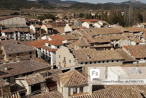 View of Rubielos de Mora  traditional buildings with arabic tiles at the roof  Mudejar church and rural landscape  province of Teruel  Aragón Region  Spain  Europe