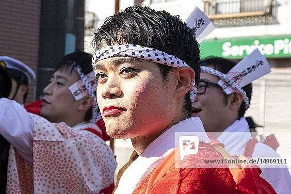 February 24  2019  Tokyo  Japan - Participants dressed in women's kimonos and wearing makeup  are seen during the Ikazuchi no Daihannya festival. Festival volunteers carry 6 containers from the Shinzoin Temple around the neighborhood to chase away evil spirits.The origins of this annual event are disputed  but the legend tells the priest of Shinzoin Temple visited house to house to prevent the spread of cholera during the late Edo era. Another legend of a man who lived in the neighborhood dressed in women's kimono to scare away the bad spirits for his sister who was suffering from tuberculosis.