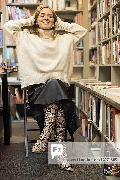 Fashionable German blogger woman in library  Munich  Germany