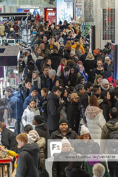 Hordes of shoppers throng the Macy's Herald Square flagship store in New York looking for bargains on the day after Thanksgiving  Black Friday  November 23  2018. Many retailers have spread 'Black Friday' over the Thanksgiving week  including opening on Thanksgiving Day  thinning some of the crowds that traditionally mobbed the stores.