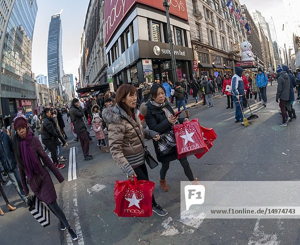 Hordes of shoppers outside the Macy's Herald Square flagship store in New York looking for bargains on the day after Thanksgiving  Black Friday  November 23  2018. Many retailers have spread 'Black Friday' over the Thanksgiving week  including opening on Thanksgiving Day  thinning some of the crowds that traditionally mobbed the stores.
