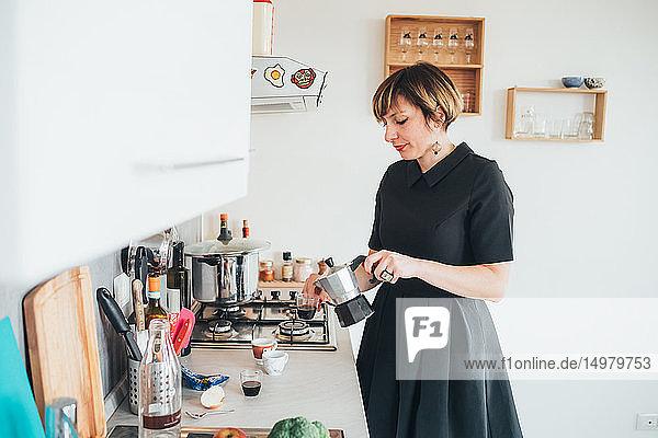 Businesswoman making coffee