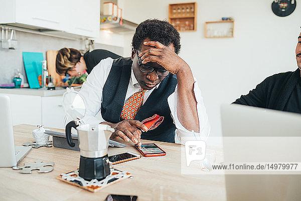 Businessman using smartphone in loft office