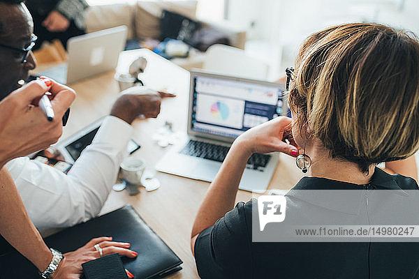 Businessmen and businesswomen having discussion in loft office