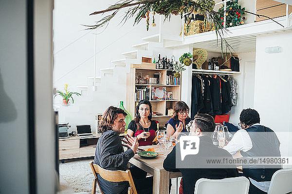 Businessmen and businesswomen on lunch break in loft office