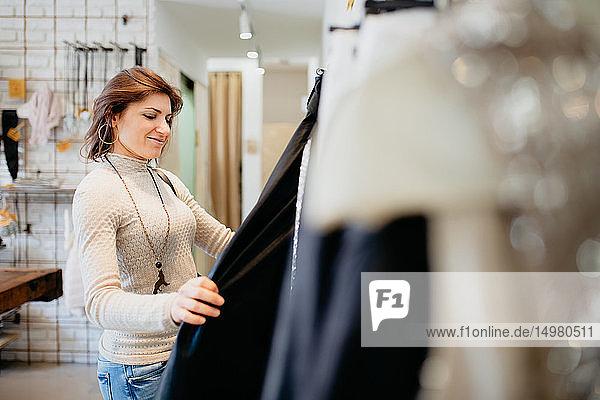 Woman shopping in fashion boutique