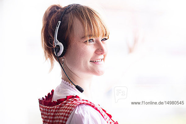 Portrait of woman wearing telephone headset