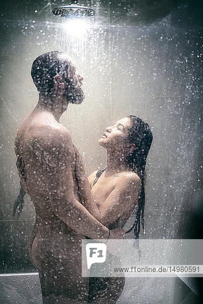 Naked hipster couple in shower