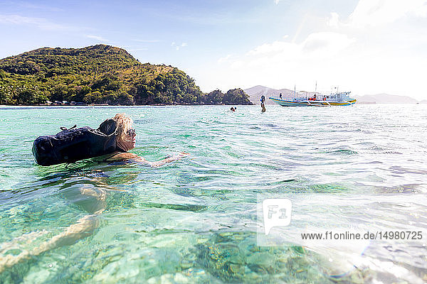 Woman swimming in sea  Ginto island  Linapacan  Philippines