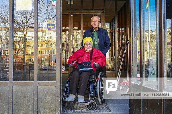 Stockholm  Sweden A priest fromt the Swedish Church helps an older woman from a nursing home go to church on Sunday.