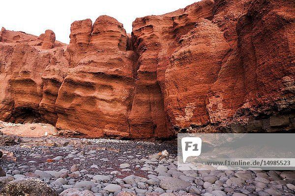 The eroded rocky levels of the volcanic red mountain. El Golfo  Lanzarote. Spain.