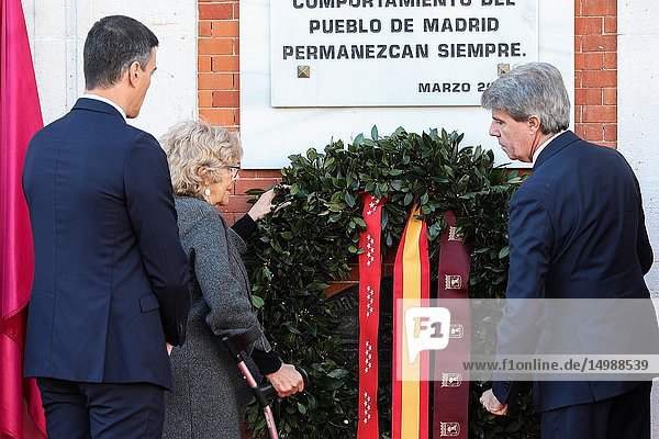 Angel Garrido(R)  Pedro Sanchez(L)  Manuela Carmena(C) and member of the foundations AVT seen attending the floral offering in the event of tribute to the victims of the 11M.