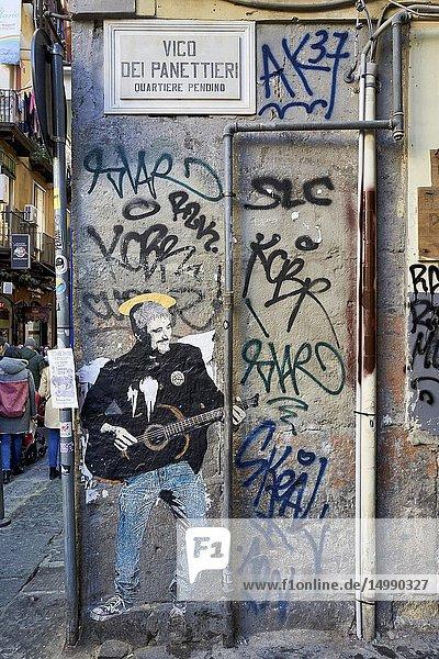 Naples Campania Italy. Street graffiti depicting Pino Daniele  famous italian singer.