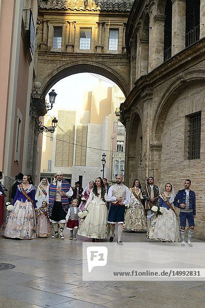The fallera and the falleros deliver the flowers very excited. Each fallera carries a bouquet of keys that adorn a mosaic of the coat of the Virgen de los Desamparados  Valencia  Spain.