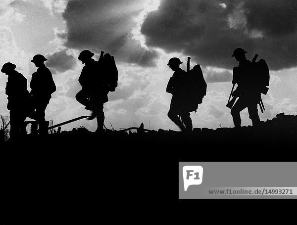 BELGIUM Frezenberg -- 04 Oct 1917 -- Men of the 8th Battalion  East Yorkshire Regiment going up to the line near Frezenberg Belgium during the Battle of Broodseinde on the Western Front near Ypres - which was part of the larger Battle of Passchendaele during World War I -- Picture by Ernest Brookes/Lightroom Photos.