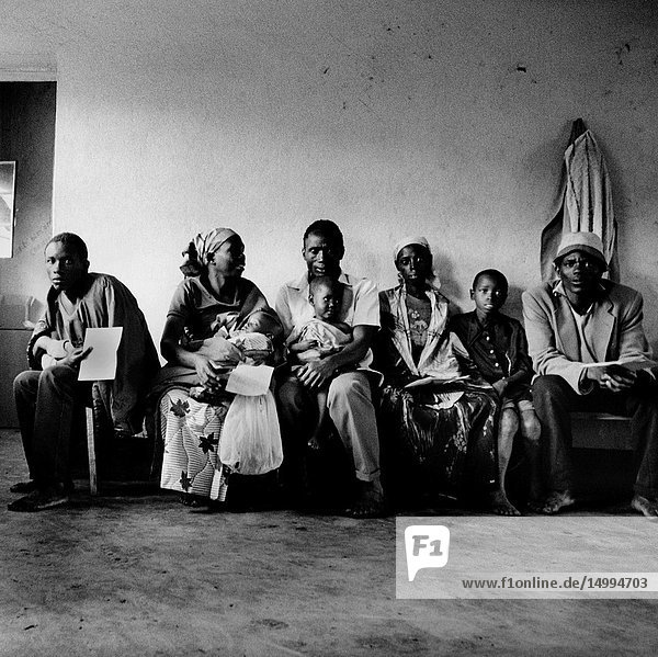 RWANDA Butare -- 01/01/1994 -- Burundian refugees wait for treatment in a temporary clinic in a refugee camp. Health conditions were so bad at the camp that it is likely that some the people pictured here died as a result -- Picture ©ÊWim van der Helm / Lightroom Photos.