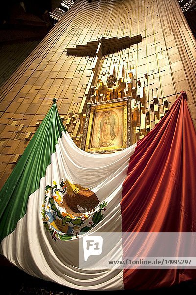 The altar with the original image of Our Lady of Guadalupe decorated with a Mexican flag in Nuestra Señora de Guadalupe Basilica in Mexico City  Mexico.