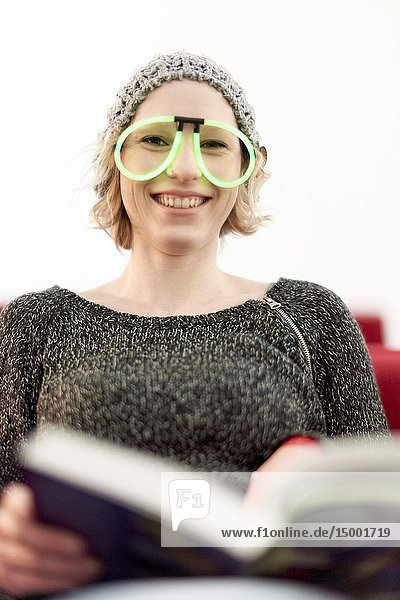 Woman with funny eyeglasses  reading book  in Munich  Germany.