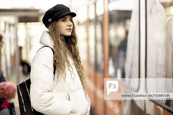 Young woman in front of public transport  in city Cottbus  Brandenburg  Germany.