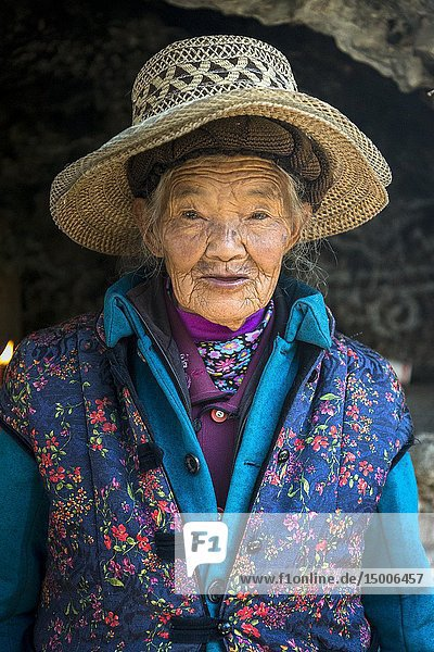 Elderly Woman at White Dragon Pool shrine near Shaxi  Yunnan  China.