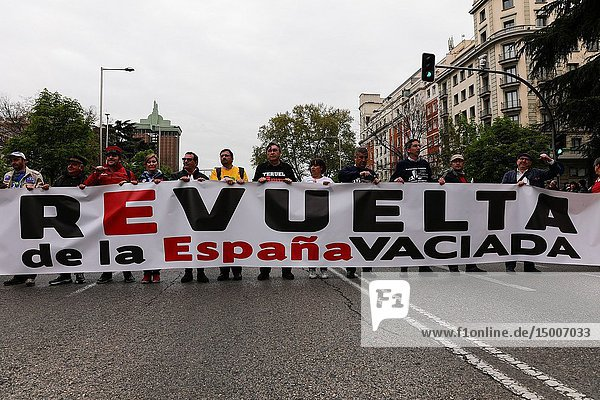 Participants seen with a banner that says Revolution of the Depopulated Spain. 'La Revuelta de la España Vaciada' from the Plaza de Colón in Madrid to Neptuno with a massive participation that makes this march historic  since it is the first time that 90 collectives from 23 provinces come together to stop depopulation