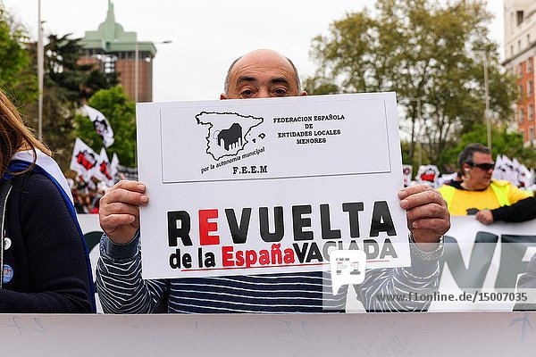Participant seen with a banner that says Revolution of the Depopulated Spain. 'La Revuelta de la España Vaciada' from the Plaza de Colón in Madrid to Neptuno with a massive participation that makes this march historic  since it is the first time that 90 collectives from 23 provinces come together to stop depopulation
