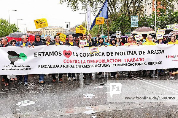 Participants seen with placards of the name their town. 'La Revuelta de la España Vaciada' from the Plaza de Colón in Madrid to Neptuno with a massive participation that makes this march historic  since it is the first time that 90 collectives from 23 provinces come together to stop depopulation