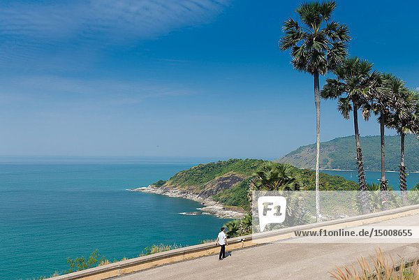 Tourist walking along the sea on Promthep Cape  Phuket  Thailand.
