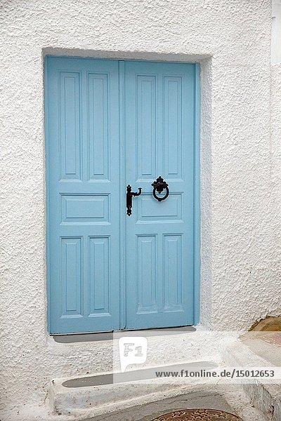 Blue entrance door to a house in Pyrgos  Santorin  Greece  Europe.
