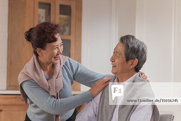 Old couple having a good time  Chinese ethnicity