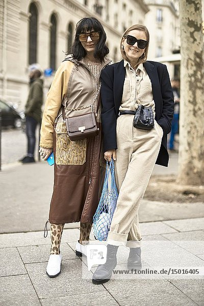 Street style - fashionable blogger duo posing at street during fashion week  in Paris  France