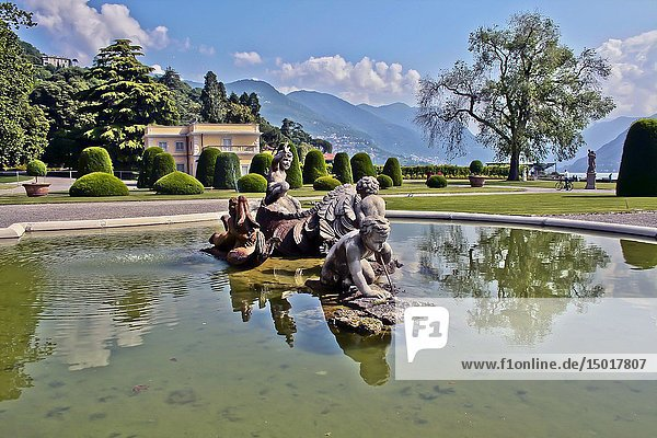 Como  Lombardy  Italy. Monumental fountain located in front of Villa Olmo  depicts a sea monster fighting with three cherubs  it is the work of the Milanese sculptor Gerolamo Oldofredi (Milan 1840-1905)  and was placed by the Visconti di Modrone dukes.