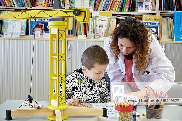 Teacher with children in a classroom of studies and games  Plant for hospitalization of children  Pediatrics  Medical care  Hospital Donostia  San Sebastian  Gipuzkoa  Basque Country  Spain.