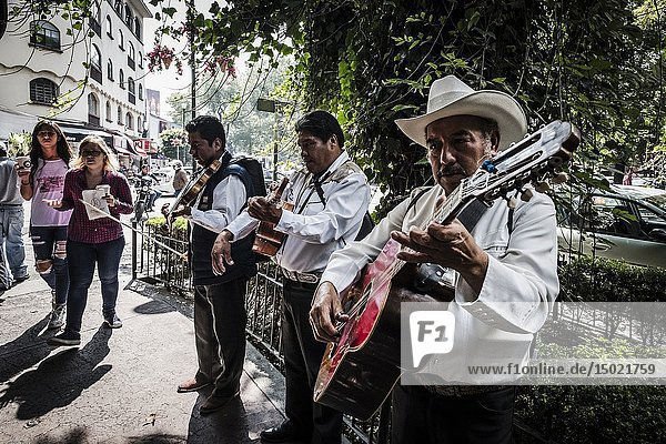 Street mexican musicians performig at Polanco  Mexico City.