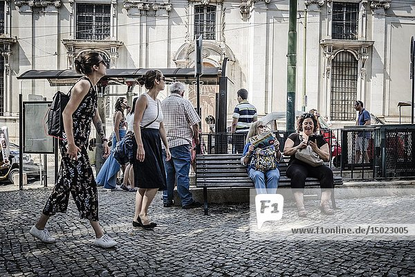 Street view with tourist near the main cathedral in Lisbon city  Portugal.