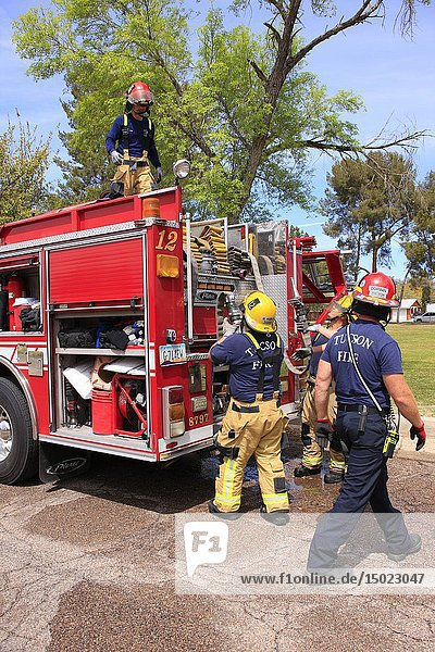 Firemen of the Tucson Fire Department finish up an emergency exercise before heading back to the station house.
