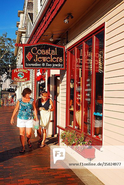 Two adult women shop at boutiques in downtown Kennebunkport  Maine.