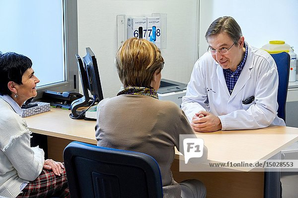 Doctor with patient in medical consultation  Oncology  Hospital Donostia  San Sebastian  Gipuzkoa  Basque Country  Spain