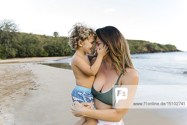 Woman with her son on beach