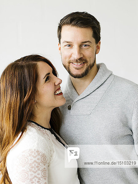 Smiling mid adult couple