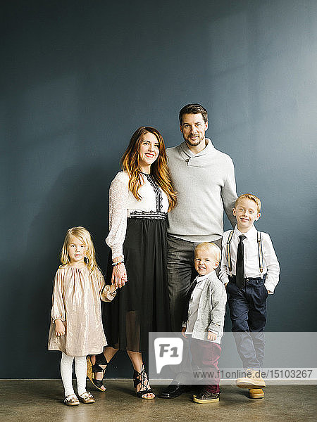 Well-dressed family with three children