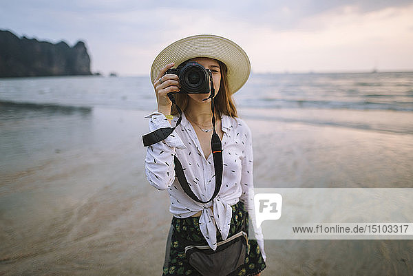 Young woman photographing on beach in Krabi  Thailand