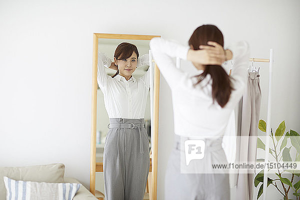 Young Japanese woman at home getting ready in the morning