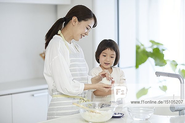 Japanese woman with daughter in the kitchen
