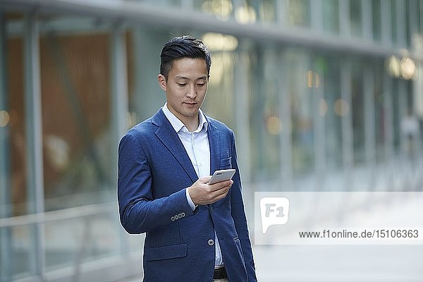 Young Japanese businessman downtown Tokyo