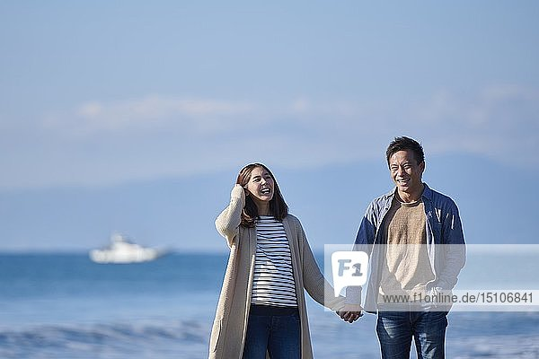 Japanese couple at the beach