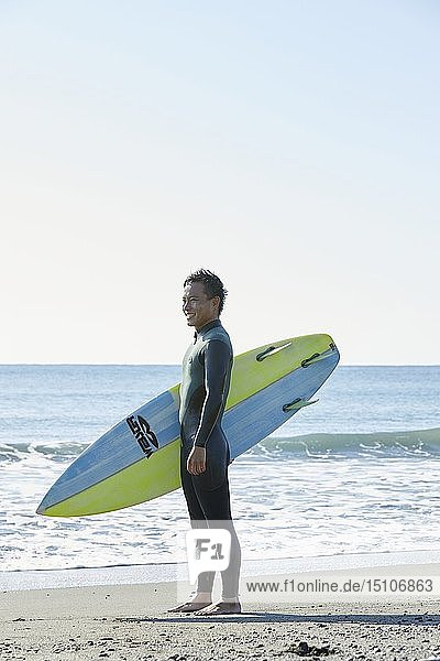 Japanese surfer at the beach