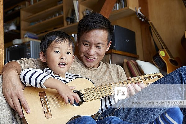 Japanese kid with father at home